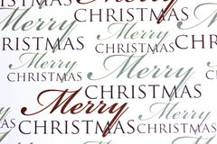 Merry Christmas words on paper background Royalty Free Stock Images