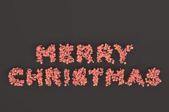 Merry Christmas words from red balls on black background. Christmas sign. 3D rendering illustration Stock Photo