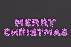 Merry Christmas words from violet balls on black background. Christmas sign. 3D rendering illustration Stock Photos