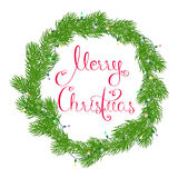 Merry Christmas wreath. Festive wreath or frame made of fir branches entangled electric glowing garland greeting Merry Christmas with beautiful calligraphy Royalty Free Stock Photography