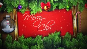 Merry Christmas Writing with Pine Branches and Ornaments stock video footage