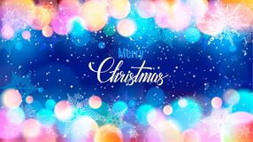 Merry Christmas writing on specks and snowflakes. Merry Christmas writing on bright background of snowflakes and specks of light Stock Photo