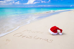 Merry Christmas written on beach white sand with Stock Images