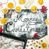 Merry Christmas. written on a black board sprinkled with flour. Christmas cooking concept Royalty Free Stock Photography