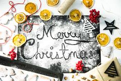 Merry Christmas. written on a black board sprinkled with flour. Christmas cooking concept Stock Photo