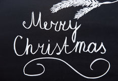 Merry Christmas written on a blackboard Royalty Free Stock Photo