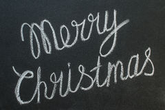 Merry Christmas written on a blackboard with chalk Royalty Free Stock Photography
