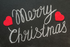 Merry Christmas written on a blackboard with chalk. Royalty Free Stock Photos