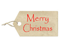 Merry Christmas written on a brown paper label on white Stock Photography