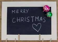 Merry Christmas written with a chalk stock photo