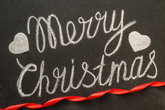 Merry Christmas written with chalk on a chalkboard. Stock Image