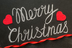 Merry Christmas written with chalk on a chalkboard Stock Photography