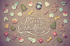 Merry Christmas! written among decorative gingerbread cookies. Vintage look added. Royalty Free Stock Photo