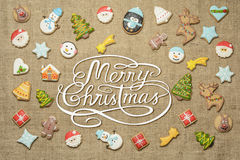 Merry Christmas! written among gingerbread cookies . Stock Photo