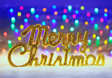 Merry christmas written in gold with lights Royalty Free Stock Images