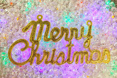 Merry christmas written in gold over ice Royalty Free Stock Photos