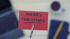 Merry christmas. Written on a memo at the office Royalty Free Stock Photo