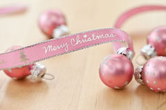 Merry Christmas written on pink ribbon. 'Merry Christmas' written on pink gift ribbon stock images