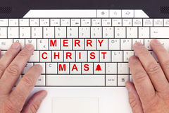 Merry christmas written replaced on a modern laptop. Keyboard royalty free stock photo