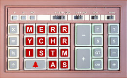 Merry christmas written replaced on an old calculator. Keypad royalty free stock image