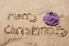 Merry Christmas written in the sand Royalty Free Stock Images
