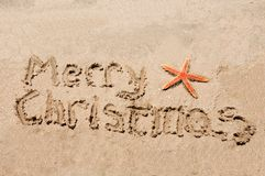 Merry Christmas written in the sand Royalty Free Stock Photo