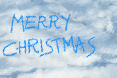 Merry christmas written in the snow Royalty Free Stock Image
