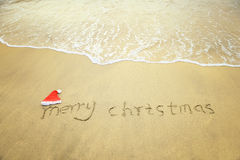 Merry Christmas written on tropical beach white sand Royalty Free Stock Photos