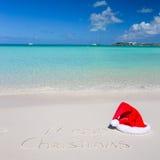 Merry Christmas written on tropical beach white Stock Photo
