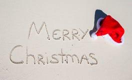 Merry Christmas written on tropical beach white Royalty Free Stock Photos