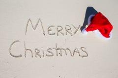 Merry Christmas written on tropical beach white Royalty Free Stock Photo