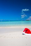 Merry Christmas written on tropical beach white Stock Images