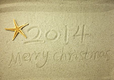 Merry Christmas written on tropical beach white sand Royalty Free Stock Image
