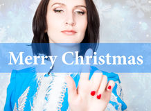Merry christmas written on virtual screen. concept of celebratory technology in internet and networking. woman in Royalty Free Stock Photos