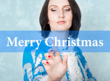 Merry christmas written on virtual screen. concept of celebratory technology in internet and networking. woman in Stock Images