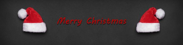 Merry christmas xmas greeting banner or header. With two santa hats Royalty Free Stock Photo