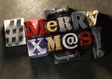 Merry Christmas Xmas title in vintage wood block text and hashta Stock Images