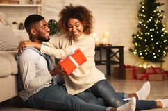Free Merry Christmas. Young Couple Celebrating Christmas At Home Stock Photo - 160917980