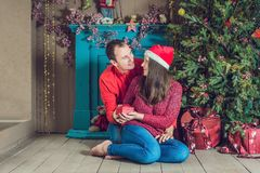Merry Christmas. Young couple celebrating Christmas at home stock photography