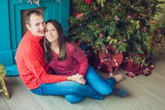 Merry Christmas. Young couple celebrating Christmas at home royalty free stock photos