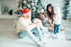 Merry Christmas.Young family celebrating Christmas at home. Royalty Free Stock Image