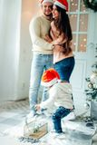 Merry Christmas.Young family celebrating Christmas at home. Stock Image