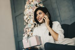 Merry Christmss and Happy New Year!  Young beautiful woman talki Stock Images