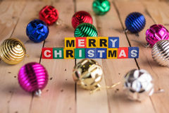 Merry chritmas  decoration with wooden text and shiny balls.jpg Stock Photography