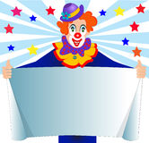 Merry clown keeps paper for message Stock Image