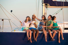 Merry company celebrates birthday on a yacht. stock photography