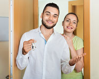 Merry couple coming to the apartment Stock Photo