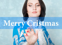 Merry cristmas written on virtual screen. concept of celebratory technology in internet and networking. woman in Stock Image