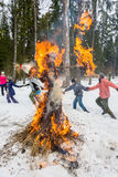 Merry dance around the burning effigy of Maslenitsa Royalty Free Stock Image