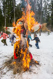 Merry dance around the burning effigy of Maslenitsa Stock Images